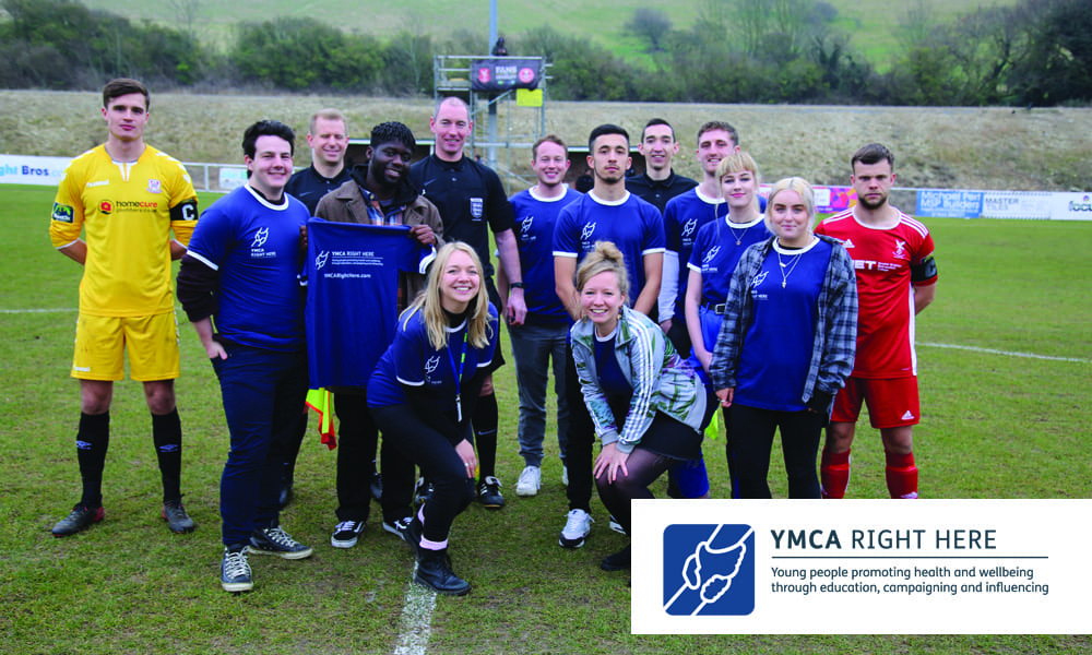 YMCA Right Here Team in a football field